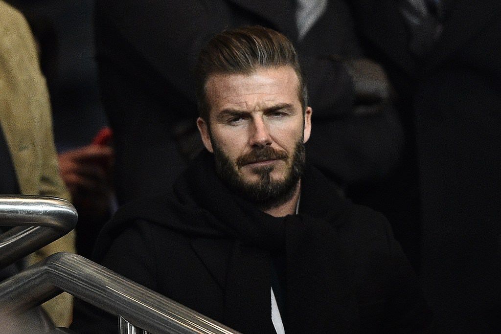 Former English footballer David Beckham attends the UEFA Champions League round of 16 football match between Paris Saint-Germain (PSG) and Chelsea at the Parc des Princes stadium in Paris on February 17, 2015.  AFP PHOTO / FRANCK FIFE